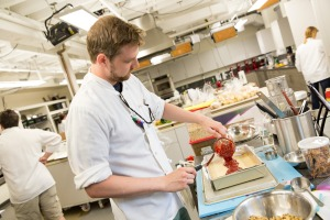Test cook Russell Selander prepares a fruit-based streusel bar.